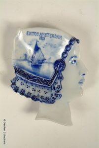 Schaaltje in vorm van hoofd Koningin Wilhelmina gemaakt t.g.v de ENTOS: De Eerste Nederlandsche Tentoonstelling op Scheepvaartgebied 1913